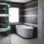Minimalist-modern-bathroom-design-ideas-2014-with-White-bathtub-and-curved-wall-glass-shower-area-also-grey-wall-tile-pattern-ideas-915x686