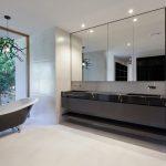 black white style bathroom overlooking garden area 3