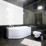 black white walled bathroom gold accents 3