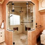 traditional-bathroom-steam-shower-wood-cubicle-doors-orange-wall-paint-crown-molding-faux-finish-glass