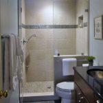 интерьер ванной в темном цвете со светом и картиной
