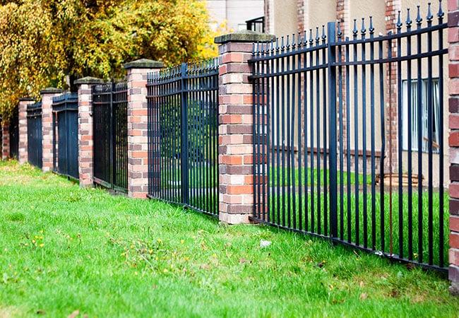 Black Metal Fence With Brick 1